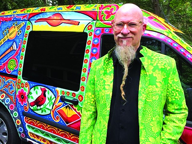 INSPIRATIONAL TRANSPORT: DIY multi-instrumentalist Klimchak, who will be performing at The Bakery on April 24, stands proudly beside his trusty Ford Transit, which has been painted by Pakistani truck artist extraordinaire Haider Ali. Photo by Anne Cox.