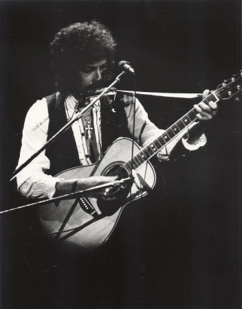 HE NOT BUSY BEING BORN IS BUSY DYING: Bob Dylan, seeing the light, live at the Omni in 1978.